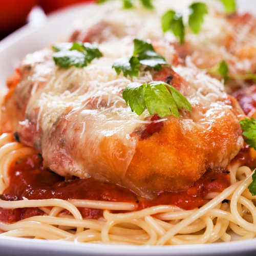 Parmesan chicken steak with cheese, spaghetti and tomato sauce